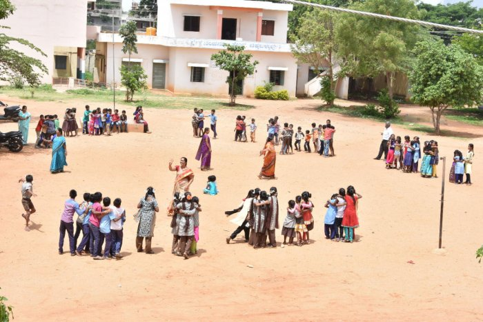 Teachers monitor students who play different games at model higher primary school ground on B B Road in Chikkaballapur town on Saturday DH Photo