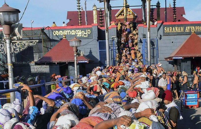 **FILE** Sabarimala: In this file photo dated Nov 18, 2013, devotees wait at Lord Ayyappa temple, in Sabarimala. The Supreme Court today said women have the constitutional right to enter Sabarimala temple in Kerala and pray like men without being discrimi