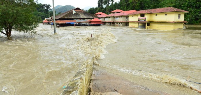 The river Pampa breached its banks on Monday, flooding shops, pilgrim facilities and the mandapam on the foothills of Sabarimala. Photo by special arrangement