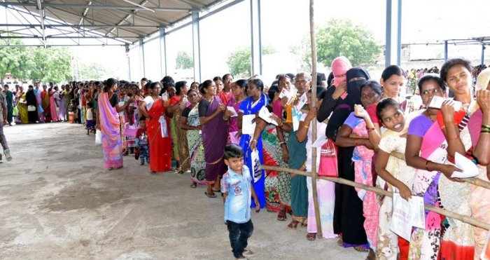 A file photo of people waiting to collect sarees from TRS leaders as part of the Bathukamma saree scheme in 2017.