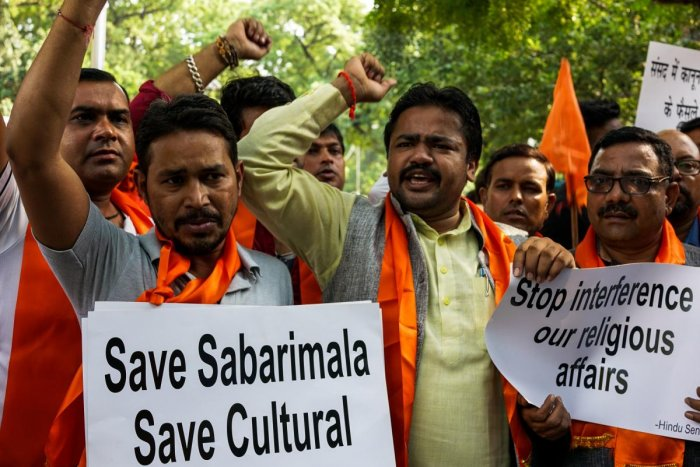 Members of the Hindu Sena shout slogans as they protest against the Supreme Court decision to allow women of all ages to enter inside the Sabarimala temple, in New Delhi on Thursday. AFP