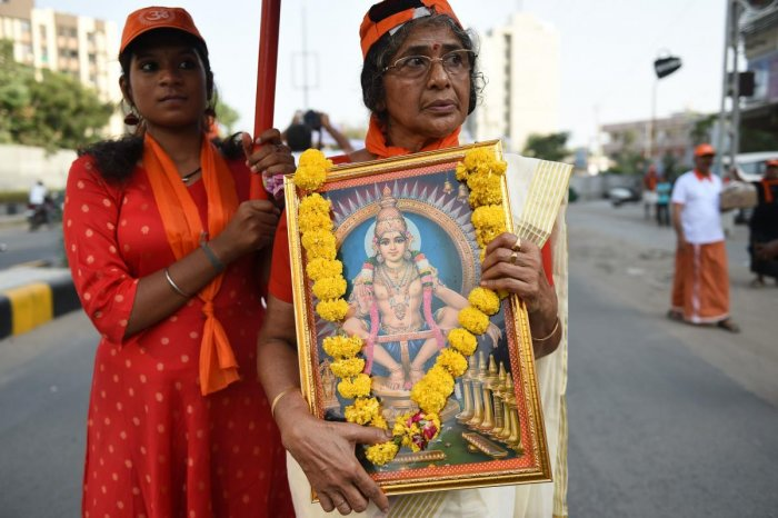 Ayyappa devotees participate in a peaceful protest rally against the Supreme Court decision to allow women of all ages to enter the Sabarimala temple, in Ahmedabad. (AFP File Pic)