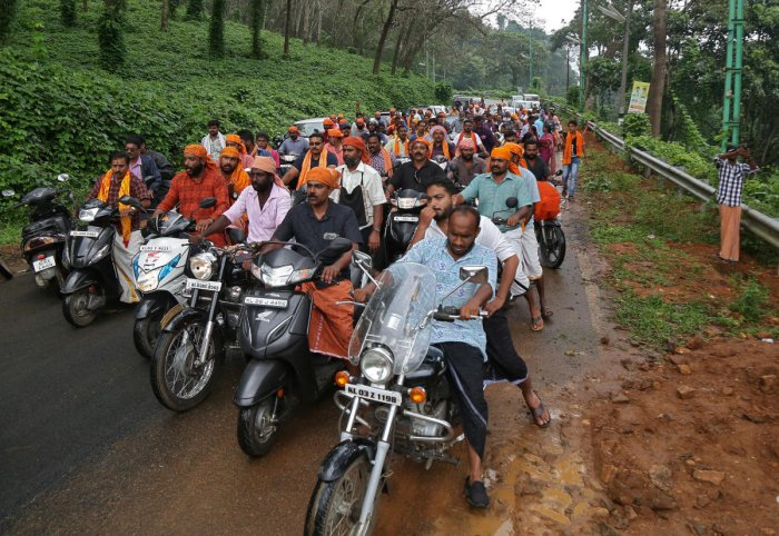 Hindu devotees take part in a motorcycle rally as part of a protest against the lifting of ban by Supreme Court that allowed entry of women of menstruating age to the Sabarimala temple, at Nilakkal Base camp in Pathanamthitta district in the southern stat