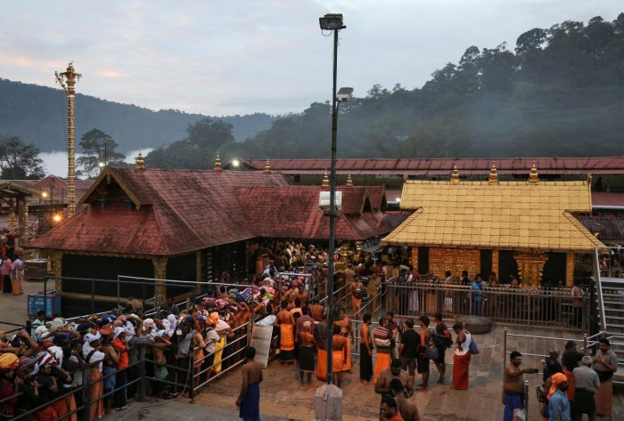 Devotees wait in queues inside the premises of the Sabarimala temple in Pathanamthitta district. Reuters file photo