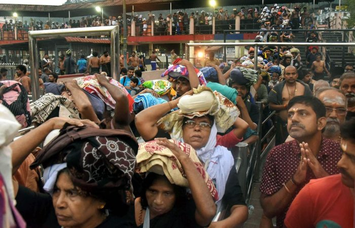 Devotees arrive to pay obeisance at Lord Ayyappa Temple in Sabarimala (PTI Photo)