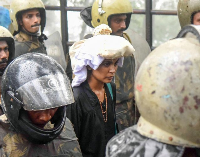 Sabarimala: Activist Rehana Fathima being escorted by the police to Sabarimala Temple, Kerala, Friday, Oct 19, 2018. Rehana Fathima and journalist Kavitha Jakkal were taken to the temple but the priest, reportedly, locked it and the women had to return mi