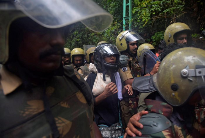 Police officers escort Rehana Fathima (C), who made an attempt to enter Sabarimala temple which traditionally bars the entry of women of menstrual age in Pathanamthitta. Reuters photo