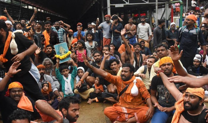 Protesters oppose the entry of women to the Sabarimala Temple, Kerala, on Friday. PTI