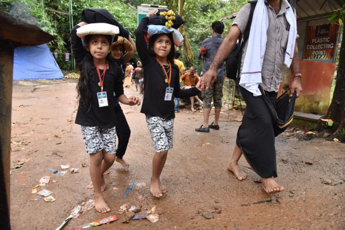 More men are taking along their little daughters to Sabarimala, thinking they may have no chance to make the pilgrimage again till they are 50. DH photos by B H Shivakumar