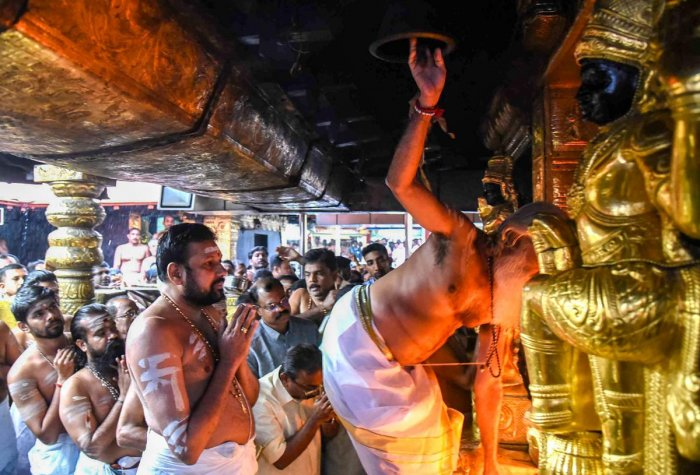 The temple opened on Friday amid a tense standoff involving social activist Trupti Desai in Kochi and a move by its administrator to seek time from the Supreme Court to implement its verdict. PTI Photo