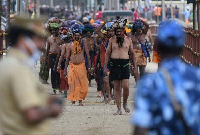 Police standing guard as devotees trek to the Sabarimala temple in Kerala. AFP