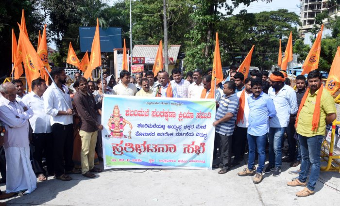 Sabarimala Samrakshana Samiti conducts a protest in front of the DC's office in Mangaluru on Tuesday, against the Kerala government's policies in the Sabarimala issue.