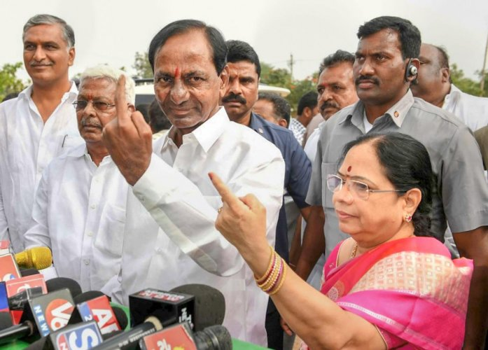 Telangana caretaker Chief Minister K Chandrasekhar Rao and his wife Shobha show their ink-marked finger after casting vote for the state Assembly elections, at a polling station in Hyderabad. PTI File Photo