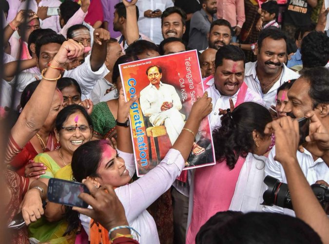 Telangana Rashtra Samithi (TRS) Party workers celebrate their party's victory in the states Assembly elections, at Telangana Bhavan in Hyderabad, Tuesday, Dec. 11, 2018. (PTI Photo)
