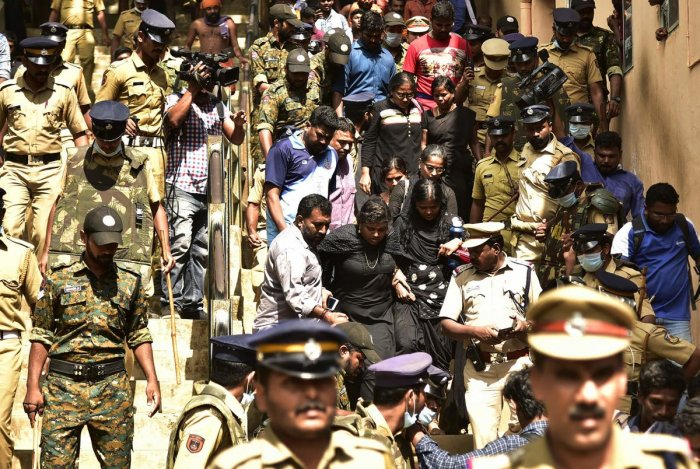 On Sunday, the Sabarimala foothills had witnessed high drama as hundreds of devotees blocked paths and chased away a group of 11 women of menstruating age being escorted to the hill shrine by police. (AFP Photo)