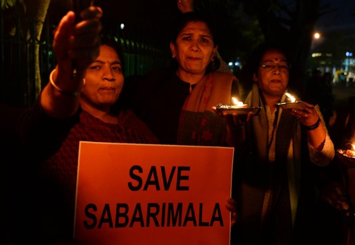Devotees participate in a candlelight vigil to protest against the Supreme Court's order revoking the traditional ban on the entry of women aged between 10 to 50 years inside the Sabarimala temple, in New Delhi on January 21, 2019. AFP