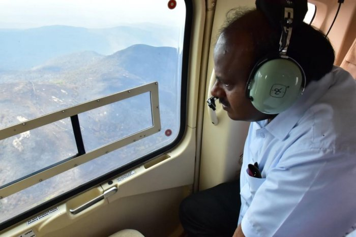 Chief Minister H D Kumaraswamy surveys Bandipur forest fire damage from a helicopter. DH photo.