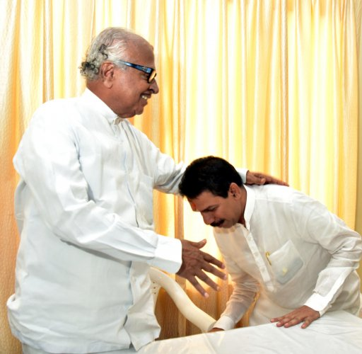 BJP candidate and MP Nalin Kumar Kateel seeks blessings of veteran Congress leader Janardhan Poojary in Mangaluru.