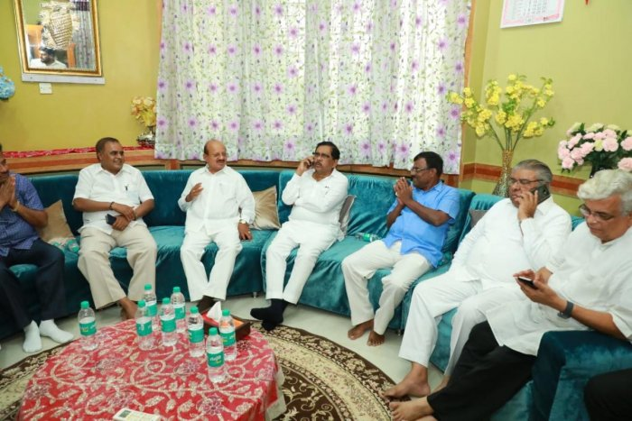 Deputy Chief Minister G Parameshwara holds meeting with Congress and JD(S) leaders at his residence in Tumakuru on Sunday. Small-Scale Industries Minister S R Srinivas, Congress leaders T B Jayachandra, E Radhakrishna among others are seen. DH PHOTO