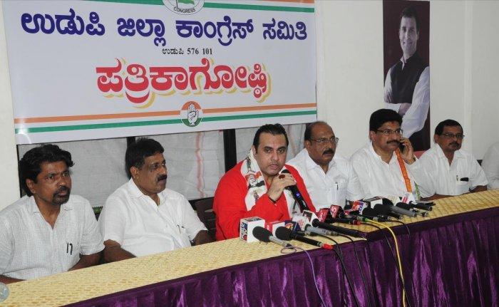 Congress and JD(S) coalition candidate Pramod Madhwaraj speaks to mediapersons in Udupi on Sunday.