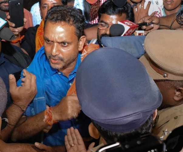 BJP's Kerala state general secretary K Surendran being taken into preventive detention near Sabarimala by the state police when he came to visit Sabarimala, Saturday. Nov 17, 2018. (PTI Photo)