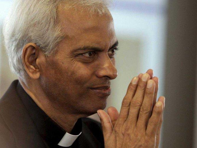 Fr Tom has happy home-coming in Kerala