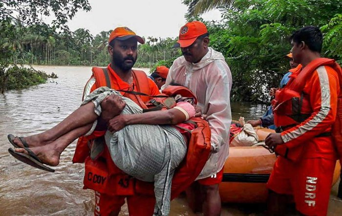 Wayanad: NDRF personnel rescue the flood-hit people in Wayanad, Kerala. PTI photo