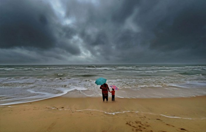 A woman standing with her son at Marina beach. PTI file photo