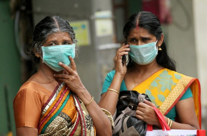 Family members of a patient infected by Nipah virus wear safety masks at the Kozhikode Medical College hospital. pti