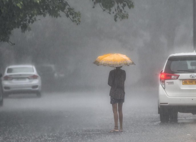A girl holds an umbrella while walking during monsoon rains in New Delhi on Friday, Aug 10, 2018. PTI Photo