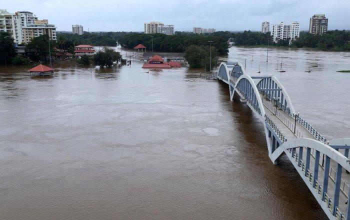A view of the overflowing Periyar river at Aluva in Kerala on Thursday. (AFP)