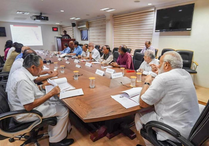 Prime Minister Narendra Modi during a review meeting on his arrival to take stock of the flood situation, in Kochi on Saturday. PTI
