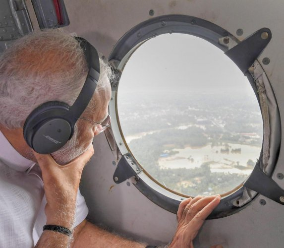 Prime Minister Narendra Modi conducts an aerial survey of flood-affected areas in Kerala on Saturday. (PIB Photo via PTI)