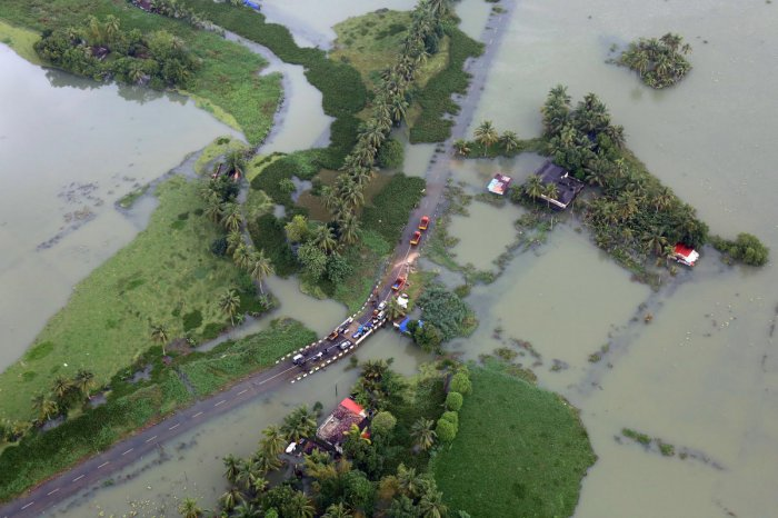 An aerial view shows partially submerged road at a flooded area in the southern state of Kerala. (Reuters photo)