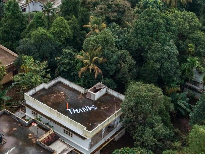 Kochi: 'Thanks' is written on the roof of a building to convey Kerala people's gratitude to Indian Navy and Air Force for their rescue and relief operations towards the flood-affected people, at North Paravoor in Kochi on Monday, Aug 20, 2018. (PTI Photo)