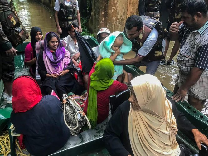 Indian Army personnel rescue flood-affected people in Ernakulam district of Kerala on Tuesday. PTI Photo