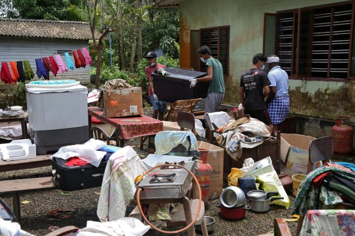 Volunteers collect household items in the lawns of a residential house before cleaning the house following floods in Kuttanad in Alappuzha district in the southern state of Kerala, India, August 28, 2018. REUTERS