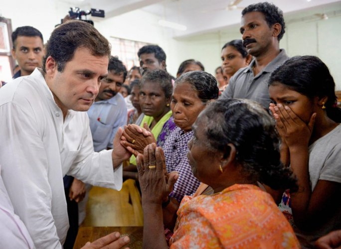 Congress President Rahul Gandhi interacts with the flood-affected people at a relief camp in Chengannur, Alapuzha, Kerala on Tuesday, August 28, 2018. (PTI Photo)