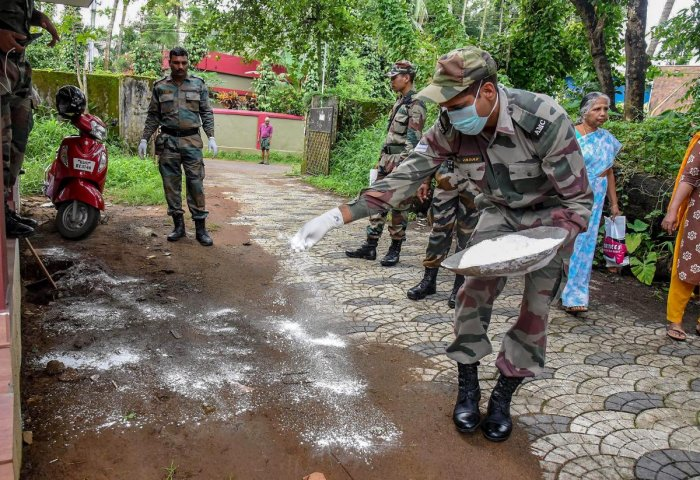 Military Medical Services personnel sanitize a flood-hit school in Kochi. PTI