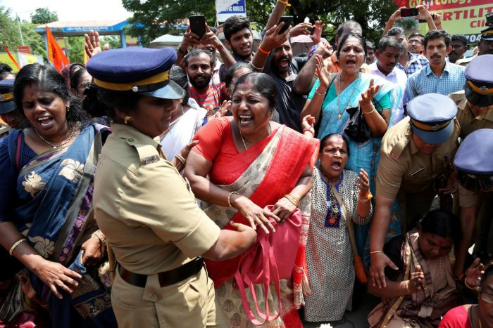 A woman reacts as she is detained by a police officer during a protest called by various Hindu organisations against the lifting of ban by Supreme Court that allowed entry of women of menstruating age to the Sabarimala temple, in Kochi, India, October 10,