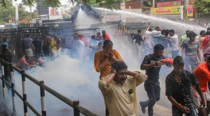 Police personnel use water cannon to disperse 'Yuvamorcha' activists marching to the house of Kerala Devaswom Minister Kadakampally Surendran's residence demanding that the state government file a review petition against the Supreme Court's Sabarimala verdict, in Thiruvananthapuram on Thursday. PTI