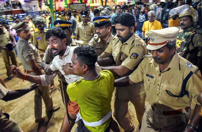 Police personnel detain the devotees who were staging 'Namajapa' protest against the police restrictions at Sannidhanam, in Sabarimala, Sunday night, Nov. 18, 2018. (PTI Photo)