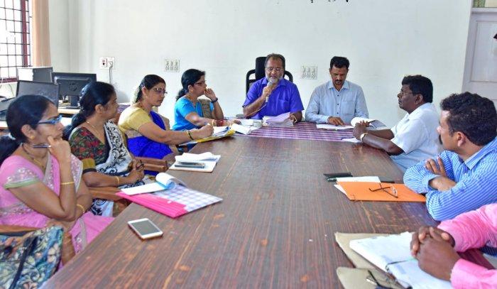 Mangaluru Tahsildar Guruprasad chairs a SC/ST grievance redressal meeting at Mini Vidhan Soudha in Mangaluru on Monday. Taluk Panchayat Executive Officer Raghu Alanahalli looks on.