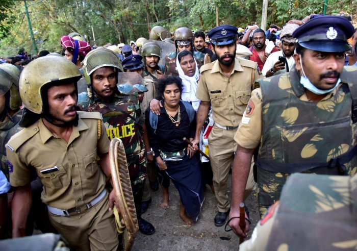 Bindu Ammini, 42, and Kanaka Durga, 44, are escorted by police after they attempted to enter the Sabarimala temple in Pathanamthitta district. Reuters File Photo