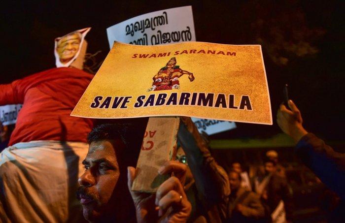 Members of Ayyappa Dharma Samrakshana Samithi (Delhi and NCR) display placards during a protest over the Sabarimala issue, at Kerala House, in New Delhi on Jan 3, 2019. (PTI File Photo)