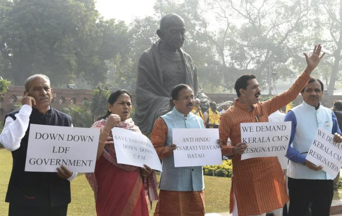 BJP MPs raise slogans against Kerala Chief Minister Pinarayi Vijayan regarding Sabarimala issue during the ongoing Winter Session of Parliament in New Delhi on Jan 4, 2019. PTI