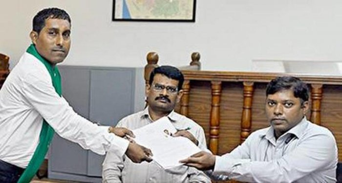 Supreeth Kumar Poojary is seen filing the nomination papers on Loktantrik Janata Dal ticket with the District Election Officer and Deputy Commissioner Sasikanth Senthil S in the DC's office, Mangaluru.