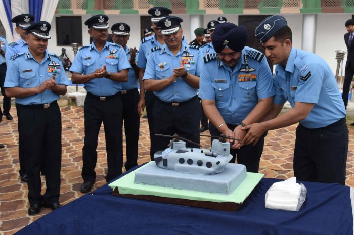 Birender Singh Dhanoa (2nd R), chief of the Air Staff of the Indian Air Force, joins other high ranking personnel to cut a Chinook shaped cake at the induction ceremony for four CH-47F Chinook helicopters at the Air Force Station Chandigarh on Monday. AFP