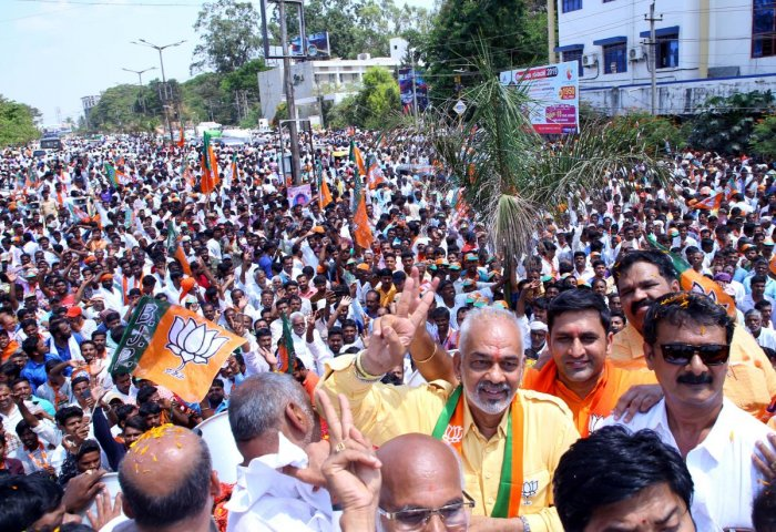 BJP candidate A Manju takes out a road show in Hassan before submitting his nomination papers for Lok Sabha elections on Monday. DH Photo