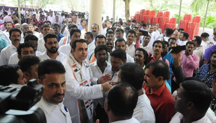 Congress workers greet Congress-JD(S) candidate Pramod Madhwaraj during his visit to Congress office in Udupi on Monday.